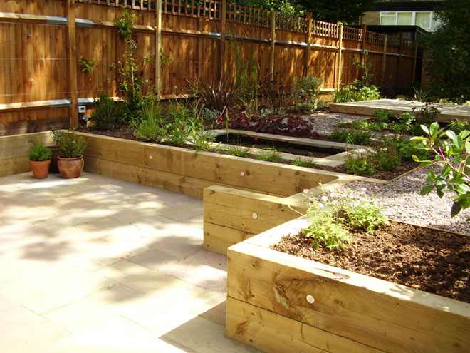Shady low maintenance garden on two levels for Low maintenance sloping garden ideas